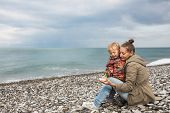 picture of mums  - Mum with small son on beach near sea - JPG