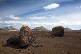 pic of hughes  - Hugh volcanic bombs in the volcanic landscape of Lanzarote - JPG