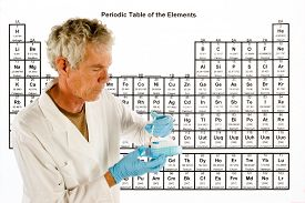 picture of periodic table elements  - Chemical engineer or doctor with laboratory equipment in front of a Periodic table of elements - JPG