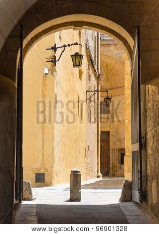 ancient archway in a street of Mdina in  Malta