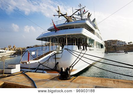 BIRGU, MALTA - APRIL 22: The luxury motor yacht with helicopter on April 22, 2015 in Birgu, Malta. M
