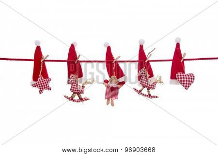 Isolated christmas decoration in red white checked colors with handmade figures on empty background.