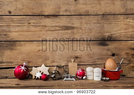 Baking in christmas time. Wooden background with kitchen equipment for cookies and cakes.