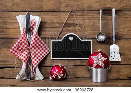 Menu card in red white checked colors with cutlery for a christmas dinner.