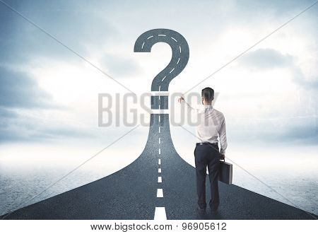 Business person lokking at road with question mark sign concept