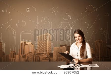 Businesswoman sitting at the black table with buildings and measurements on the background