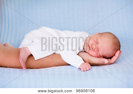 Little Baby Boy Sleeping On Arm Of His Father