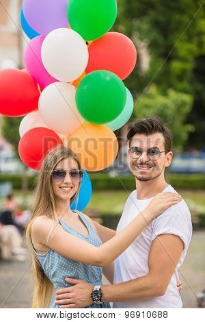 Young Couple With Balloons