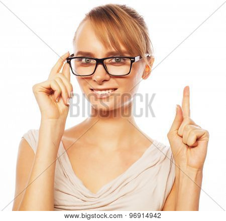 woman wearing glasses pointing up isolated on white