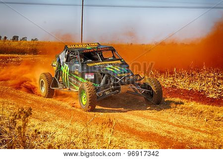 Hd - Custom Twin Seater Rally Buggy Kicking Up Trail Of Dust On Sand Track During Rally Race.