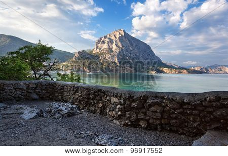Beautiful Summer Sunset At The Sea With Mountains And Stones
