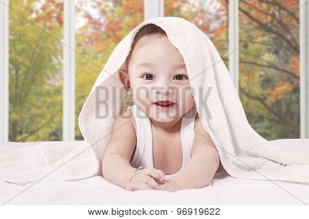 Cheerful Male Infant In The Bedroom