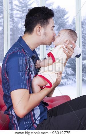 Cute Baby Kissed By His Dad At Home
