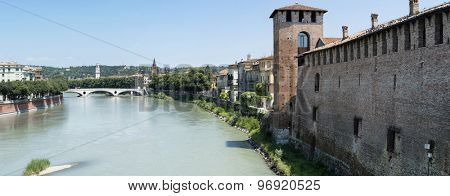 VERONA, ITALY - JULY 13: Stitched panorama of Castelvecchio and Adige river, with other areas of Verona in the background. July 13, 2015 in Verona.