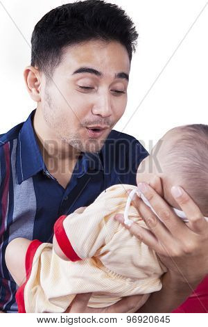 Joyful Father Playing With His Infant