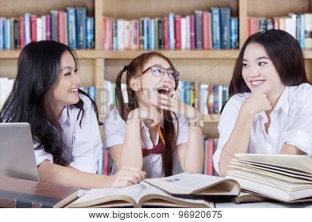 Joyful Students Talking And Laughing In Library