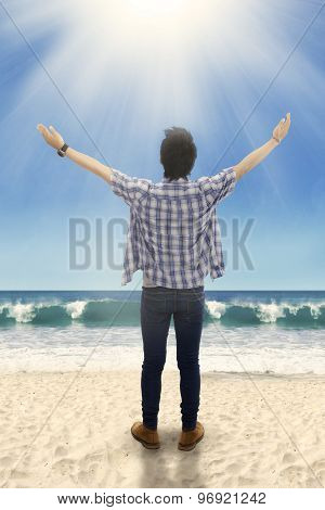Man Raised Hands At The Beach