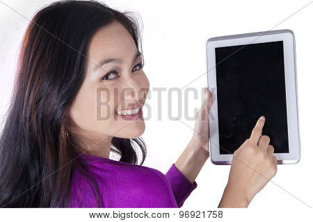 Pretty Teenage Girl Touching Tablet Screen