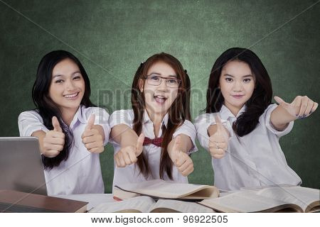 Three High School Students Showing Thumbs Up