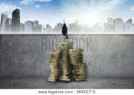 Worker Standing On Book And Look A Town