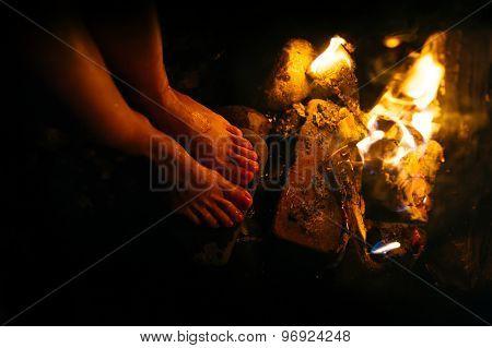 woman basks campfire