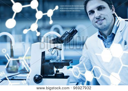 Science graphic against smiling scientific researcher with microscope in laboratory