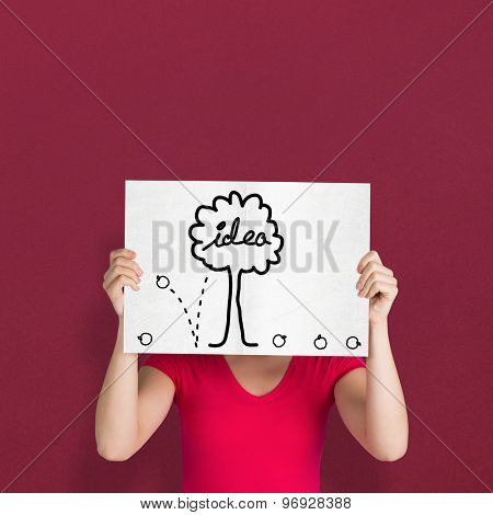 Woman in pink t-shirt showing card against red background
