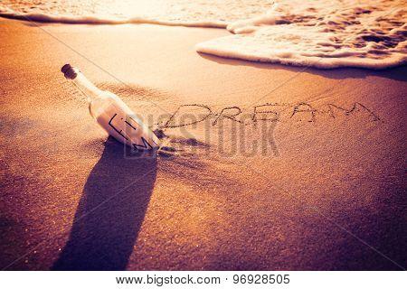 Inscription dream on sand at the beach
