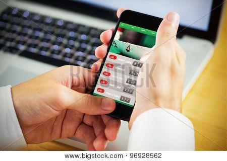 man using smartphone against gambling app screen