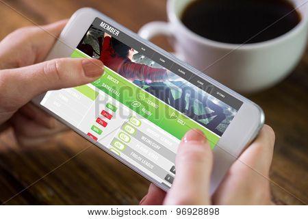 Woman using smartphone against gambling app screen