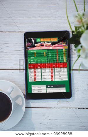Gambling app screen against tablet on desk