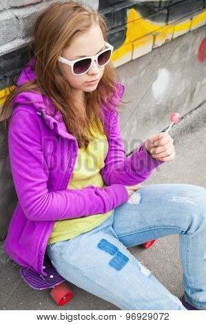 Blond Teenager Girl With A Lollipop