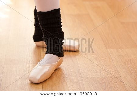 Close-up Of Ballerina's Feet During A Lesson