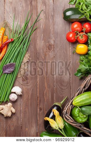 Fresh farmers garden vegetables on wooden table. Top view with copy space