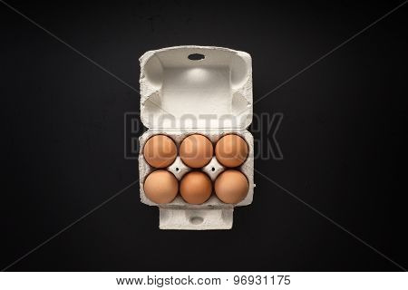 Raw Eggs In Carton Box Isolated