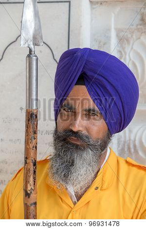 Sikh man visiting the Golden Temple in Amritsar, Punjab, India.