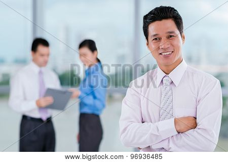 Cheerful Vietnamese Manager