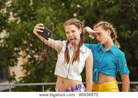 Best Friends Are Photographed In Park. Photo Phone Selfie