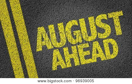 August Ahead written on the road