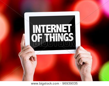 Tablet pc with text Internet of Things with bokeh background