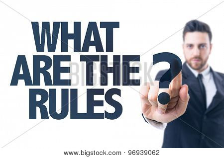 Business man pointing the text: What Are The Rules?