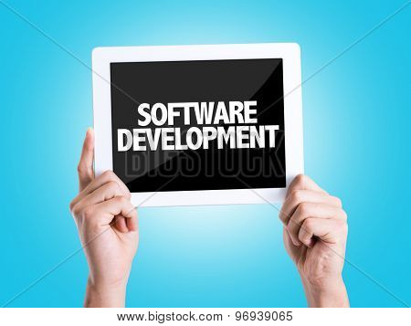 Tablet pc with text Software Development with blue background