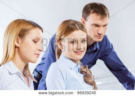 Three co-workers discussing business ideas in office