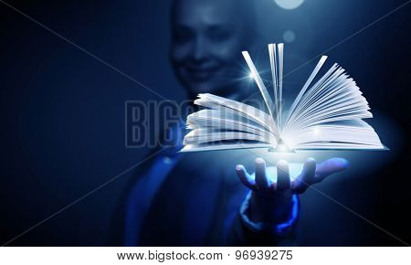 Close up of businesswoman showing media book on palm