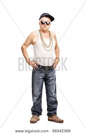 Full length portrait of a senior man in hip-hop clothes looking at the camera isolated on white background