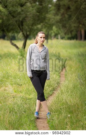 Young Woman Preparering For Sport Outdoor