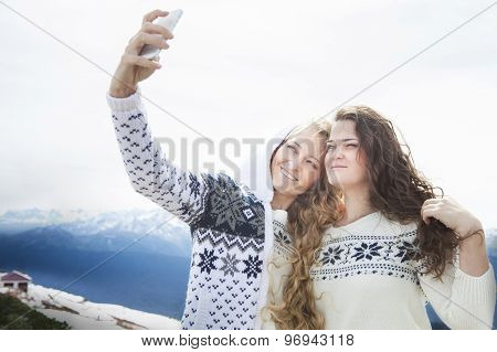 Happy Sisters Photographing A Selfie In Winter Holidays