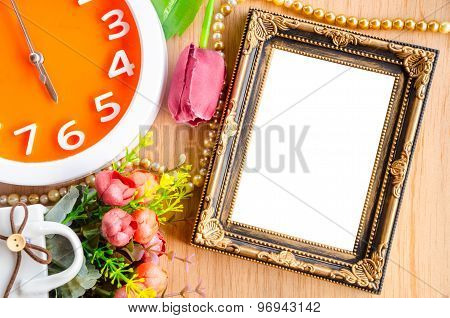 Flowers Vase And Vintage White Picture Frame.