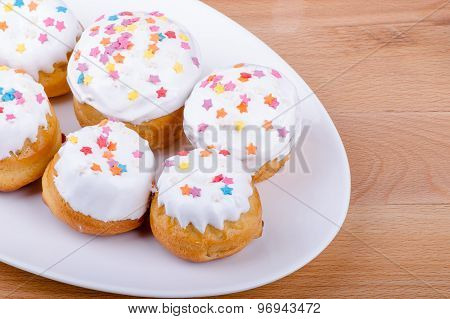 Cake on a white plate with colored sprinkles
