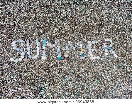 Summer Word From Stones On Pebble Beach